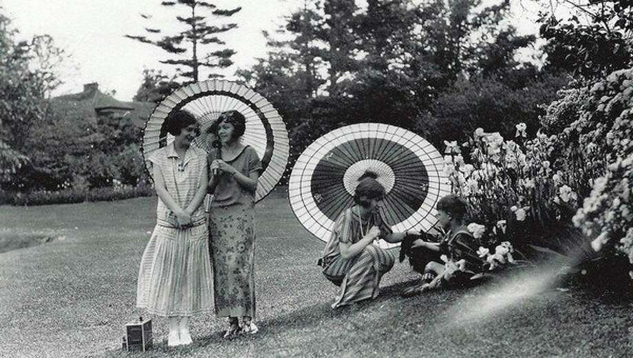 Dorothy Dow, Loretta Macomber, Margaret Dow, and Leland A. Dow spending time in the Dow Gardens, circa 1928.Movie Sundays at The Alden B. Dow Home Theater will screen many previously unseen films shot by Alden B. Dow that will include scenes of early Midland and the H.H. Dow Home. (Courtesy of the Alden B. Dow Home and Studio)