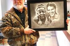 """Stan Kincaid with his drawing of Marvin """"Preach"""" Webb and Elvis."""