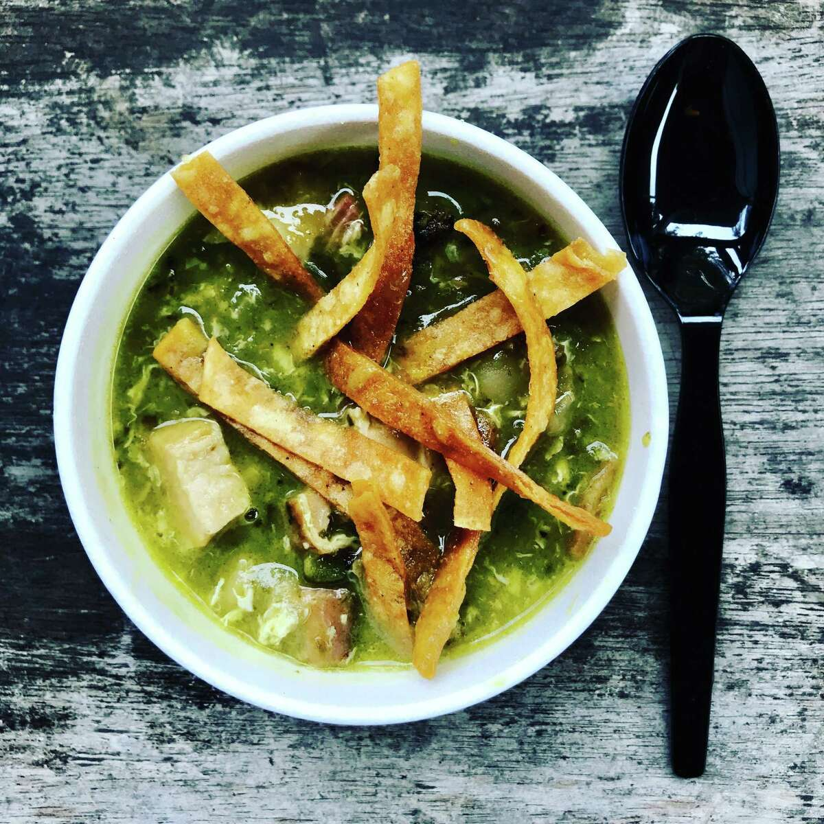 Pork belly and poblano soup with crispy tortilla strips