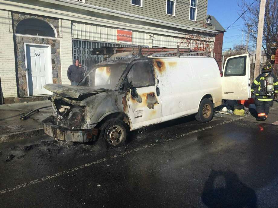 Bridgeport firefighters contain the flames of a welder's truck that caught fire Jan. 18, 2018, in Bridgeport, Conn. The blaze was on the city's East Side. Photo: John Burgeson / Hearst Connecticut Media / Connecticut Post