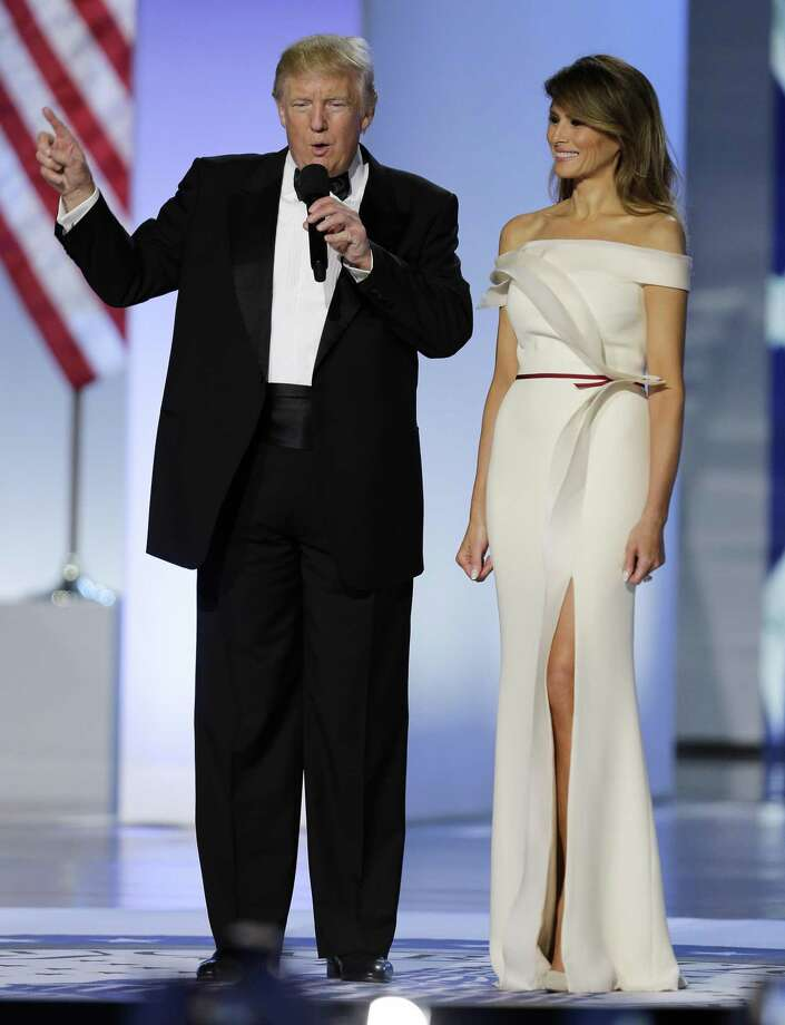 "The election of Donald Trump, shown here with first lady Melania during his inauguration last January, has spawned publication of dozens of ""resistance"" titles, including guides to activism, reflections on democracy, investigations of Russian interference in last year's election and legal analysis, along with poetry and fiction. Photo: Mark Tenally /Associated Press / FR170908 AP"