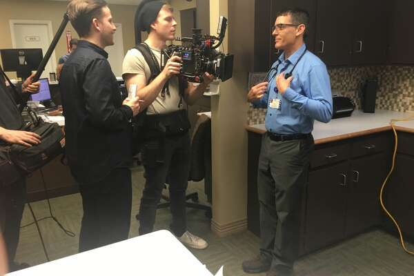 Film crews with Esquire magazine spotlight Covenant Health Plainview Family Nurse Practitioner, Greg Curry, who recently was honored with the magazine's Fighting Spirit Award. Curry was filmed with Dr. Sergio Lara at Covenant Health's Edgemere Clinic.