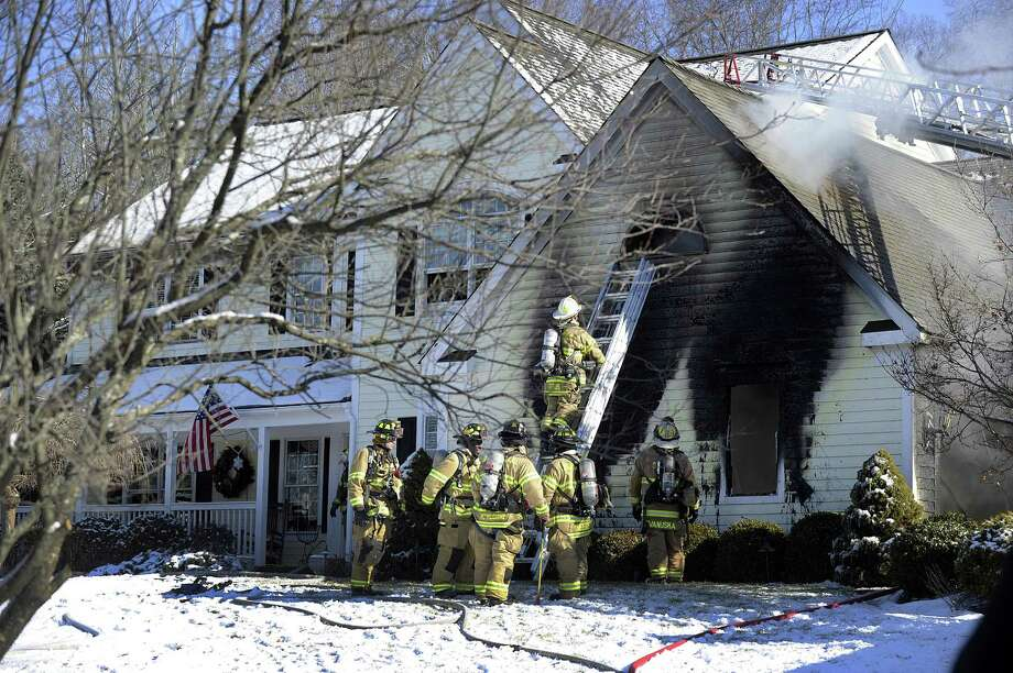 A fire broke out in a home on Muirwood Court in Brookfield, Thursday morning, January 18, 2018. Photo: Carol Kaliff / Hearst Connecticut Media / The News-Times