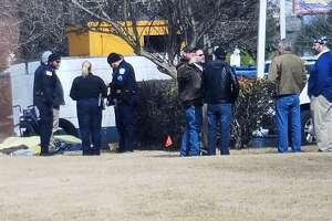Authorities investigate a scene on Laurel, where a body was found Thursday morning.  Guiseppe Barranco/The Enterprise