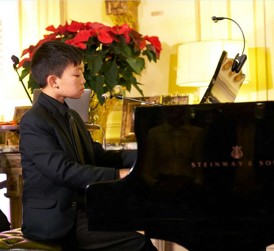 Scholarship recipient, Bryant Li performs at a Music Doing Good fundraising concert. Photo: Jay Ford