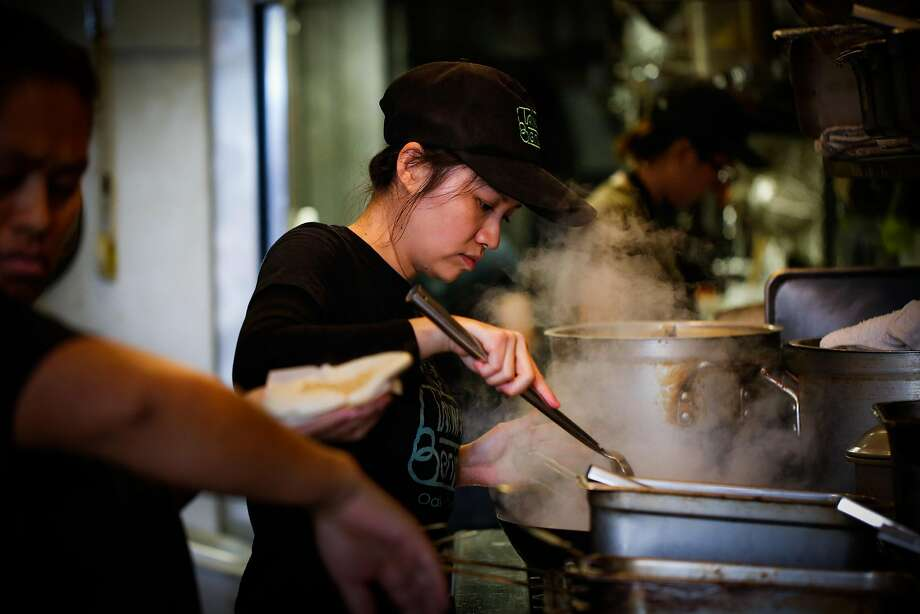 Stacy Tang cooks in her restaurant, Taiwan Bento, in Oakland. Photo: Gabrielle Lurie, The Chronicle