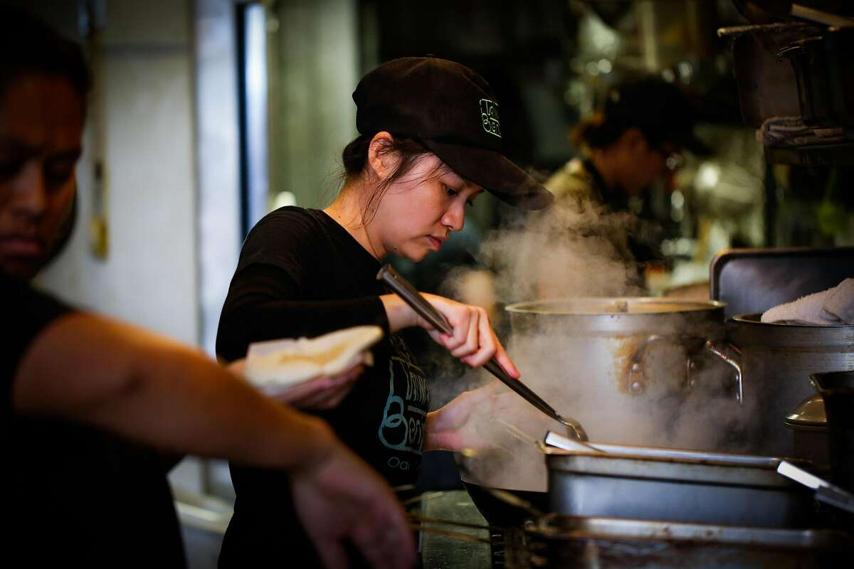 Stacy Tang cooks in her restaurant, Taiwan Bento, in Oakland.