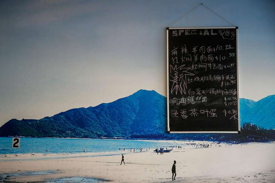 At Noodle Shanghai in San Mateo, daily specials are written in Chinese characters on a chalkboard affixed to the wall. Photo: Gabrielle Lurie, The Chronicle
