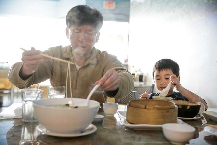Larry (declined last name) dines with his son Henry, 5 (declined last name) at Noodle Shanghai in San Mateo, Calif., on Sunday, Dec. 31, 2017.
