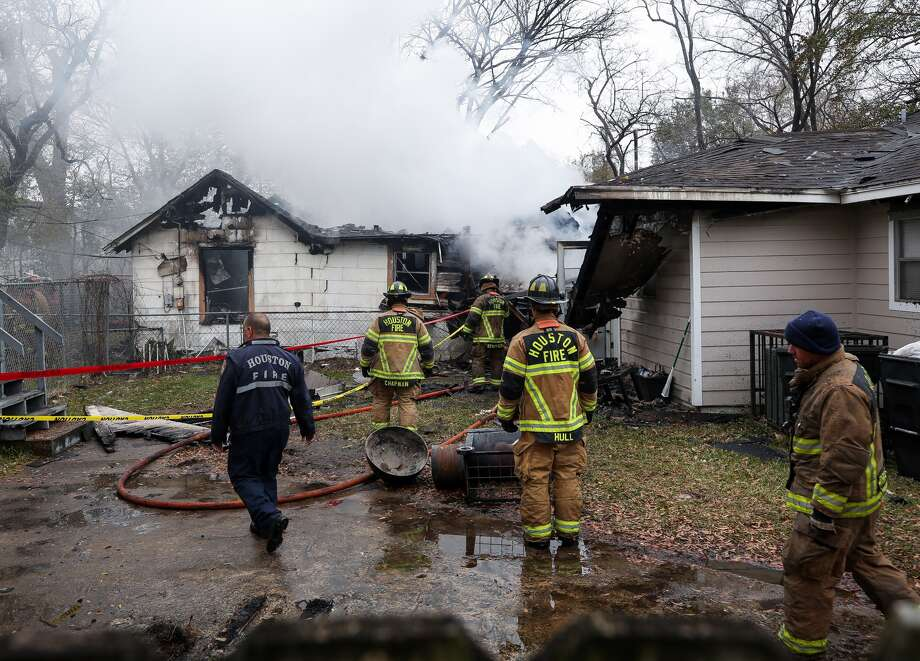 Houston fire department firefighters responded to a two-alarm residential fire on the 4100 block of Averill Street Thursday, Jan. 18, 2018, in Houston. One home was completely destroyed. (Godofredo A.Vasquez / Houston Chronicle)