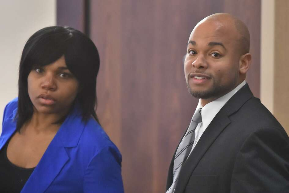 Stanyelle Miles-McCloud (left) and Alphonso McCloud arrive at the start of their dangerous dog trial in the 187th district court Thursday. They are accused of serious bodily injury after their dog vicously attacked an elderly woman, whose left arm was severed from just below the elbow.