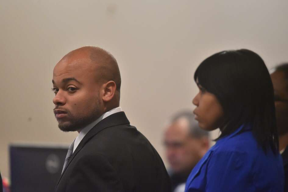 Alphonso McCloud looks over the 187th District courtroom Thursday during opening statement's in the dangerous dog trial of himself and ex-wife, Stanyelle Miles-McCloud (r). They are accused of serious bodily injury after their dog vicously attacked an elderly woman, whose left arm was severed from just below the elbow.