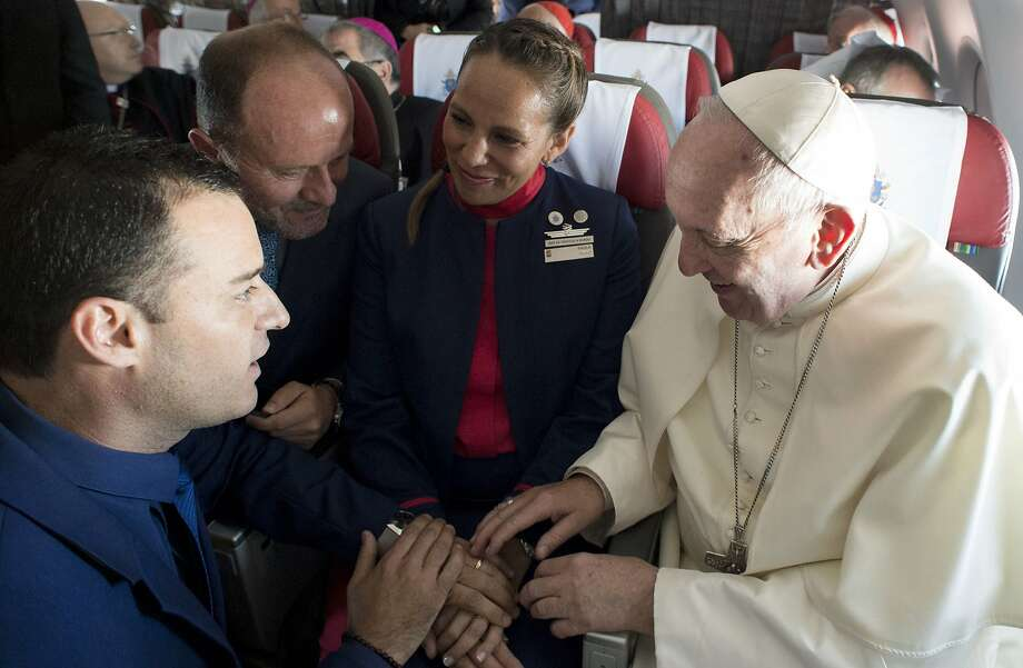 In the first-ever airborne papal wedding, Pope Francis married two Chilean flight attendants. Photo: Associated Press