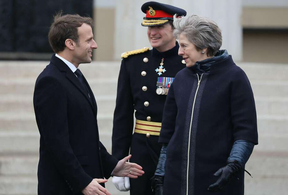 Prime Minister Theresa May met President Emmanuel Macron in Sandhurst, south of London. Photo: LUDOVIC MARIN, AFP/Getty Images