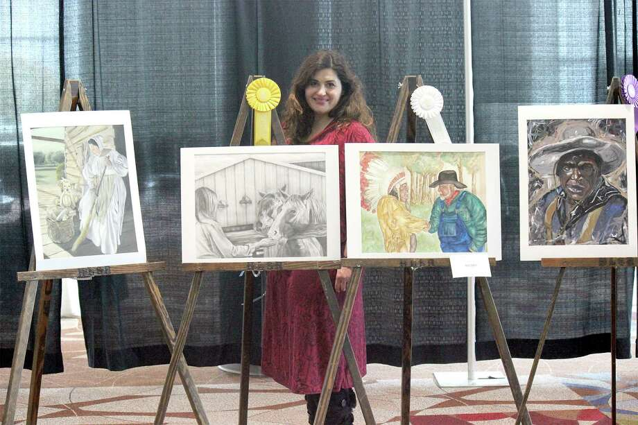 Victoria Parker, Hargrave High School Art Teacher, with Hargrave High School Best of Show, Gold Medal, and Special Merit winning Huffman ISD Rodeo Art. Photo: Huffman ISD