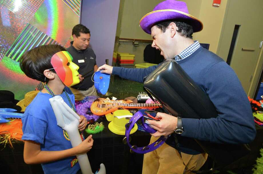 Mentor Chuck Roger and mentee Kirvin Galidamez get into character for the Lip Synch Battle during the Norwalk Mentor Program annual party Wednesday at Stepping Stones Museum for Children to celebrate the 250 mentors, mentees and families that take part in the program. Photo: Alex Von Kleydorff / Hearst Connecticut Media / Norwalk Hour