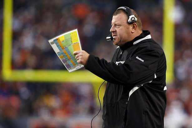 Oakland Raiders head coach Tom Cable directs his team against the Denver Broncos in the third quarter in Denver on Sunday.