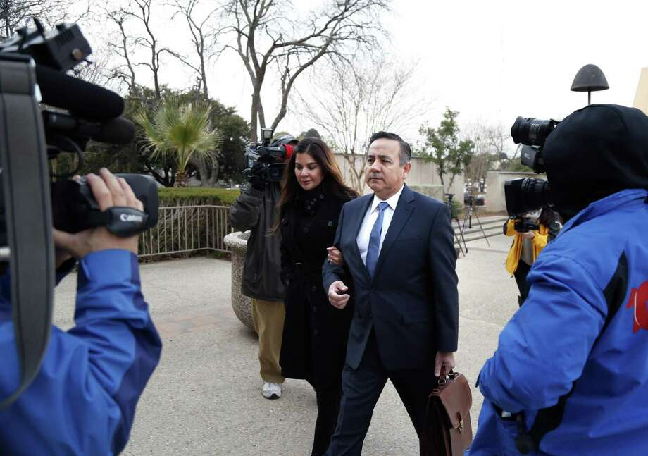 Sen. Carlos Uresti and his wife Lleanna Uresti are surrounded by media as he arrives at the John H. Wood Jr. Federal Courthouse. Sen. Carlos Uresti and co-defendant Gary Cain, not pictured, were on hand for their trial at John H. Wood Jr. Federal Courthouse on Thursday, January 18, 2018 in San Antonio, Texas. Photo: Ronald Cortes, For The San Antonio Express News / 2017 Ronald Cortes