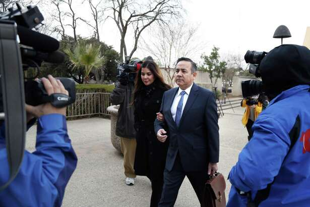 Sen. Carlos Uresti and his wife Lleanna Uresti are surrounded by media as he arrives at the John H. Wood Jr. Federal Courthouse. Sen. Carlos Uresti and co-defendant Gary Cain, not pictured, were on hand for their trial at John H. Wood Jr. Federal Courthouse on Thursday, January 18, 2018 in San Antonio, Texas.