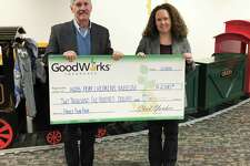 KidsPlay Children's Museum received a $2,500 donation from GoodWorks Insurance, which was named the Presenting Sponsor of the fourth annual KidsPlay Family Fun Fair in Torrington. Above,  Edward F. Ryan, senior vice president with GoodWorks Insurance, presents check to Eileen Marriott, KidsPlay Children's Museum director.