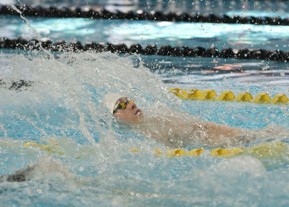 Midland Lee's Brady Cawthon swims backstroke 01/18/18 in the boys 200 yard medley relay. Tim Fischer/Reporter-Telegram