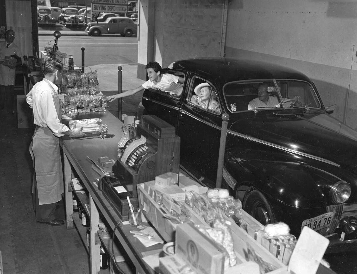 GALLERY:What California grocery stores used to look like Customers buying bread and snacks at a drive-through market and liquor store in Los Angeles in 1949.