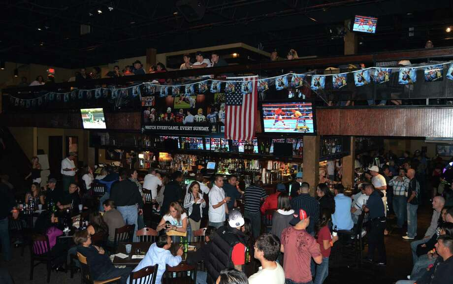 Quartermain's Pub occupies the former space of Hooligan's Bar and Grill, which used the space to house three bars, a second story, an outdoor patio, food and was jam packed as the hot spot for any big game. Photo: Express-News File Photo / SAN ANTONIO EXPRESS-NEWS