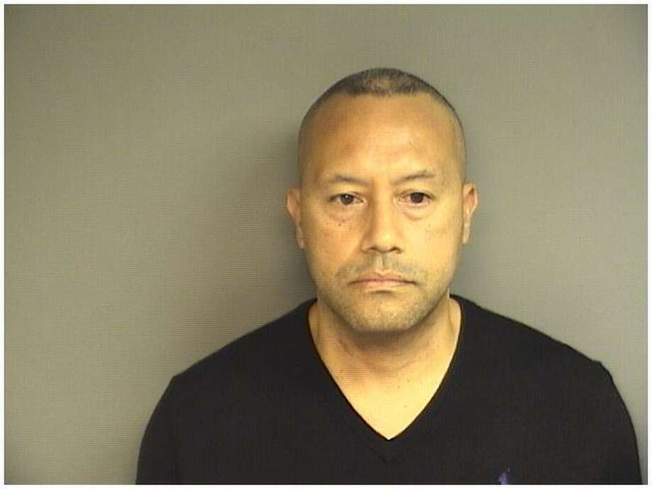 Alexander Pino, 47, of Greenwich, was charged with the sexual assault of a woman in Stamford that occurred in 2013. Photo: Stamford Police / Contributed