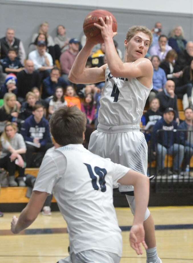 Staples senior Ben Pearl grabs a rebound in a recent game against Wilton. The Wreckers take on Greenwich at home on Friday night at 7 p.m. Photo: Alex Von Kleydorff / Hearst Connecticut Media