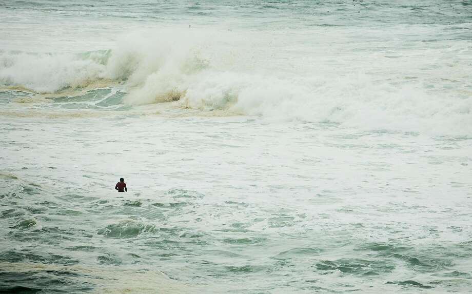 Jamie Williams tries to get out to Mavericks on a 40 to 50 foot day at Pillar Point in Princeton-by-the-Sea, Calif. Thursday, January 18, 2018. The huge white water in the channel where surfers normally paddle out made it difficult for surfers to get to Mavericks. Brian Feulner, Special to the Chronicle Photo: Brian Feulner, Special To The Chronicle