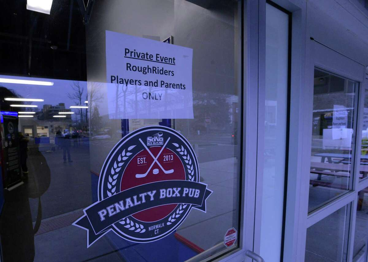 A sign is posted on an entrance informing parents and players of a private event schedule at the SoNo Ice House in Norwalk, Conn. on Tuesday, Jan. 16, 2018. Teammates and coaches of 10-year-old Nico Mallozzi, who died of complications from the flu on Sunday, met privately with a grief counselor and held a private closed practice at the facility.