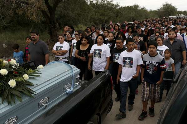 Family and friends follow the vehicles carrying the caskets of Erica Alvarado Rivera, 26, Alex Alvarado, 22, and Jose Angel Alvarado, 21, during the procession from the funeral at Nuestra SeÐora del Carmen Chuch to the cemetery for their burial in El Control, Mexico on Sunday, November, 2, 2014. TThe siblings, U.S. Citizens from Progreso, were found shot to death more than two weeks after they went missing from a restaurant near El Control.