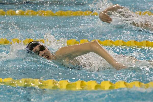 Midland High's Dailey Parker competes 01/18/18 in the girls 100 yard freestyle, taking second place with a time of 57.26. Tim Fischer/Reporter-Telegram