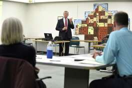 State Department of Transportation Commissioner James Redeker speaks at the Connecticut Commuter Rail Councils meeting at the Stamford Government Center on Wednesday.