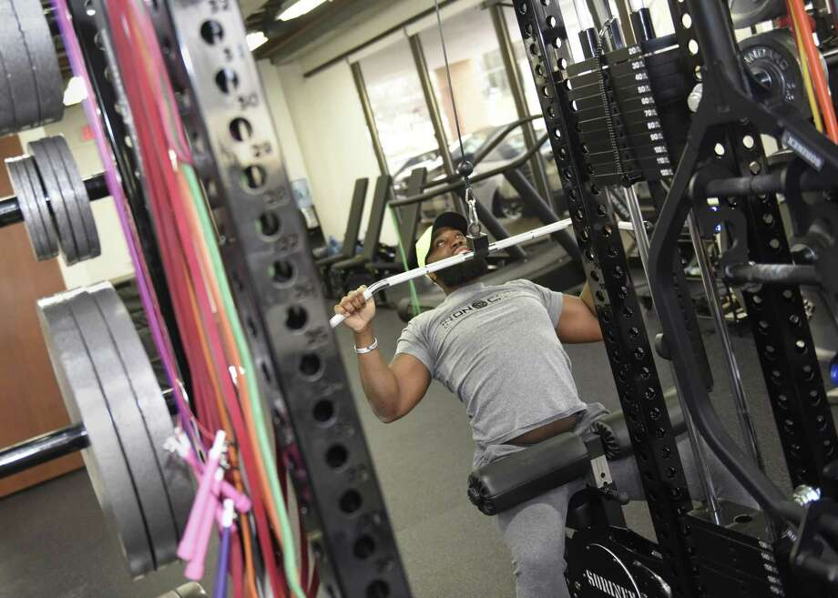 Owner and personal trainer LaRoy Warner does a lat pulldown at Iron Camp gym in Greenwich, Conn. Monday, Jan. 15, 2018. Warner is hosting an 8-week challenge to help a variety of local participants reach their fitness goals through workouts and a meal plan. Photo: Tyler Sizemore / Hearst Connecticut Media / Greenwich Time