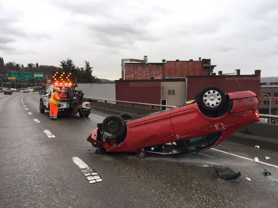 An overturned vehicle on southbound Interstate 5 near the Interstate 90 exit blocked two right lanes and slowed traffic through downtown Seattle on Thursday, Jan. 18, 2018. Photo: WSDOT