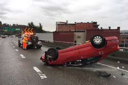 An overturned vehicle on southbound Interstate 5 near the Interstate 90 exit blocked two right lanes and slowed traffic through downtown Seattle on Thursday, Jan. 18, 2018.