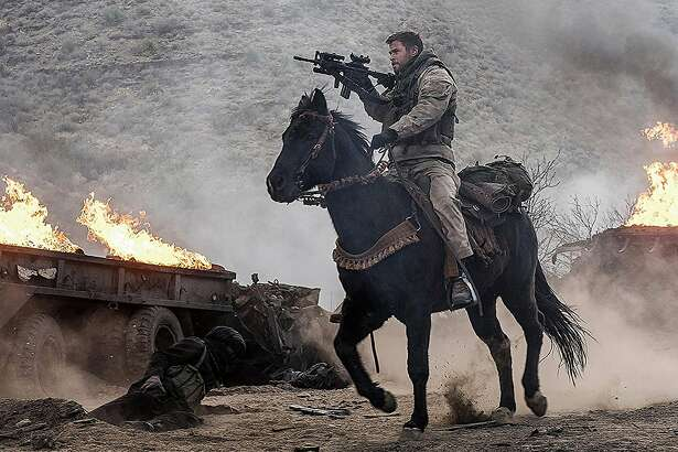"Chris Hemsworth in ""12 Strong."" (Warner Bros. Entertainment)"
