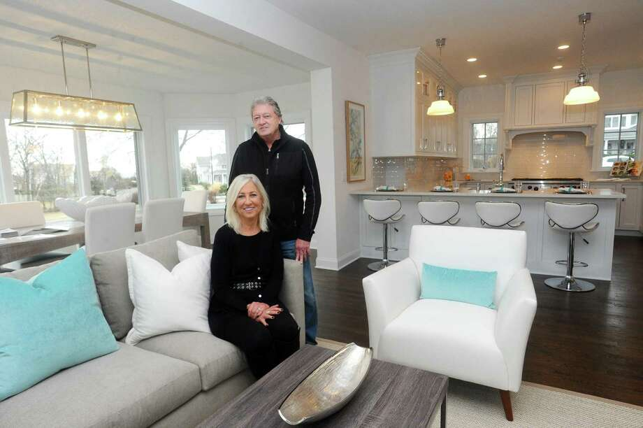Barbara and Harry Webski inside their on-the-market home on Sea Beach Drive in the Shippan neighborhood of Stamford. The Webski's recently purchased and updated the house before putting it back on the market. Photo: Michael Cummo / Hearst Connecticut Media / Stamford Advocate