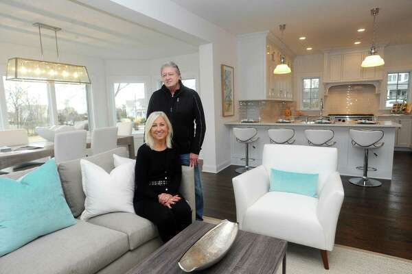 Barbara and Jason Webski pose for a photo inside their on-the-market home on Sea Beach Drive in the Shippan neighborhood of Stamford, Conn. on Tuesday, Jan. 16, 2018. The Webski's recently purchased and updated the house before putting it back on the market.