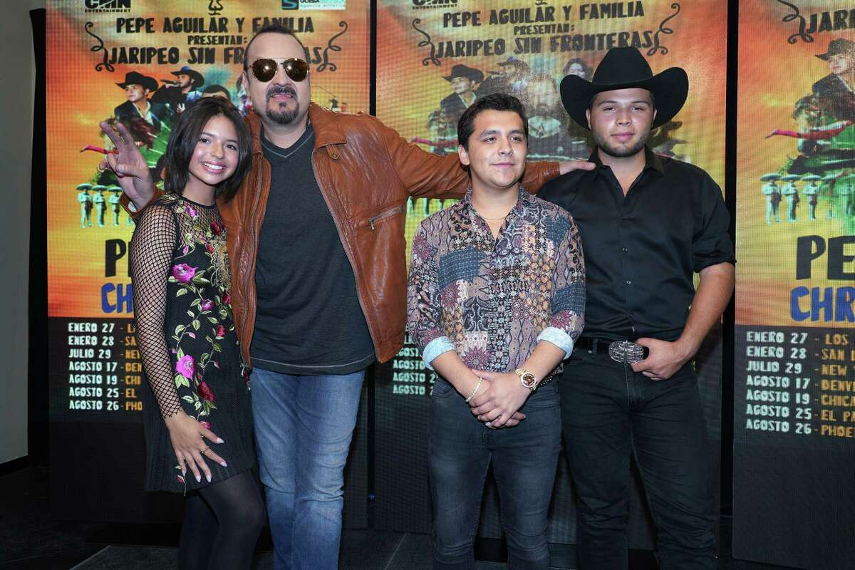 Aguilar (second from left) poses with Angela Aguilar, mariachi singer Christian Nodal and Leonardo Aguilar during a press conference to announce their upcoming tour.