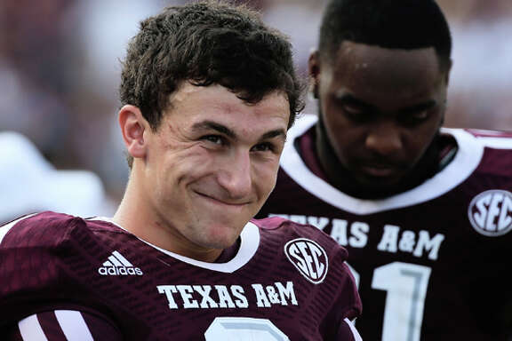 COLLEGE STATION, TX - SEPTEMBER 14: Johnny Manziel #2 of Texas A&M Aggies waits near the bench in the fourth quarter during the game against the Alabama Crimson Tide at Kyle Field on September 14, 2013 in College Station, Texas. (Photo by Scott Halleran/Getty Images)