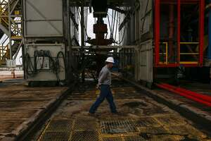A worker walks across a pad site where a drilling rig will create three to six wells next to each other at a Chevron drilling and hydraulic fracturing site Wednesday, July 19, 2017 in Midland. ( Michael Ciaglo / Houston Chronicle )