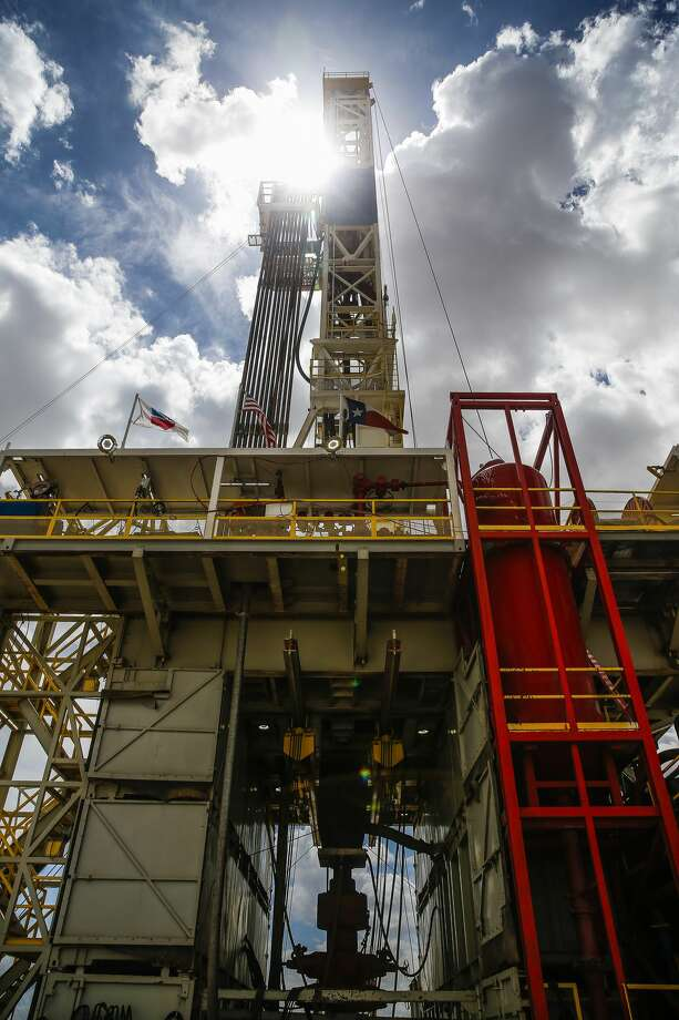 A drilling rig sits on a pad site where it will drill three to six wells next to each other at a Chevron drilling and hydraulic fracturing site Wednesday, July 19, 2017 in Midland. ( Michael Ciaglo / Houston Chronicle ) Photo: Michael Ciaglo/Houston Chronicle