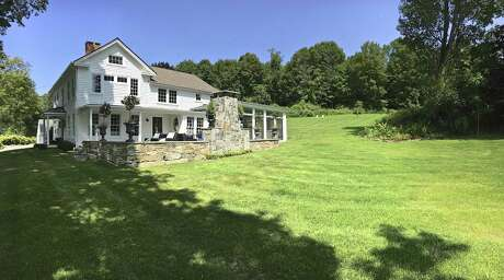 A New Milford farmhouse built in 1750 has been completely restored and upgraded by the designer and artist who live there. The house at 214 Sawyer Hill Road once belonged to Helen Gallagher, a Tony-award winning Broadway performer who also appeared in television and film. Photo: Contributed Photo/Robert Graham / The News-Times / The News-Times Contributed