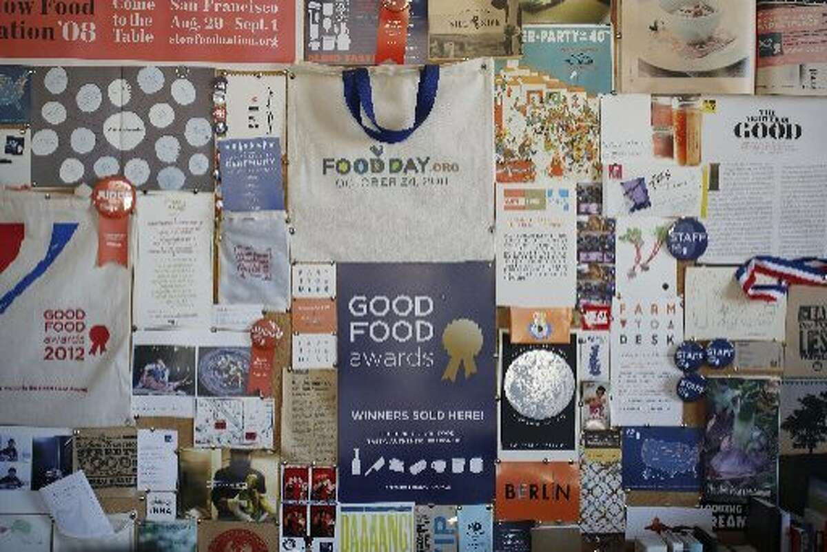 The back wall of the Good Food Awards office in Fort Mason is plastered with past successes on Tuesday Dec. 23, 2014 in San Francisco, Calif.