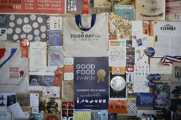 The back wall of the�Good�Food�Awards�office in Fort Mason is plastered with past successes on Tuesday Dec. 23, 2014 in San Francisco, Calif.