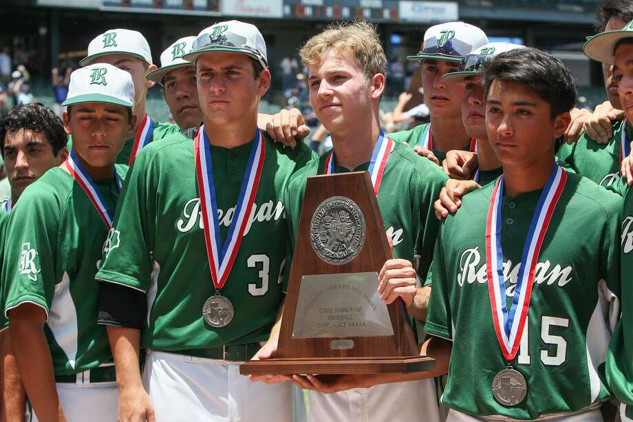 The Reagan Rattlers pose with their state runner-up trophy during their UIL Class 5A state final game with Flower Mound at Dell Diamond in Round Rock on Saturday, June 7, 2014. Flower Mound beat Reagan 10-0 in five innings to win the title. MARVIN PFEIFFER/ mpfeiffer@express-news.net Photo: MARVIN PFEIFFER, STAFF / Marvin Pfeiffer/ Express-News / Express-News 2014