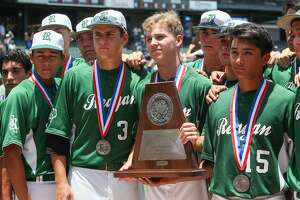 The Reagan Rattlers pose with their state runner-up trophy during their UIL Class 5A state final game with Flower Mound at Dell Diamond in Round Rock on Saturday, June 7, 2014. Flower Mound beat Reagan 10-0 in five innings to win the title.  MARVIN PFEIFFER/ mpfeiffer@express-news.net