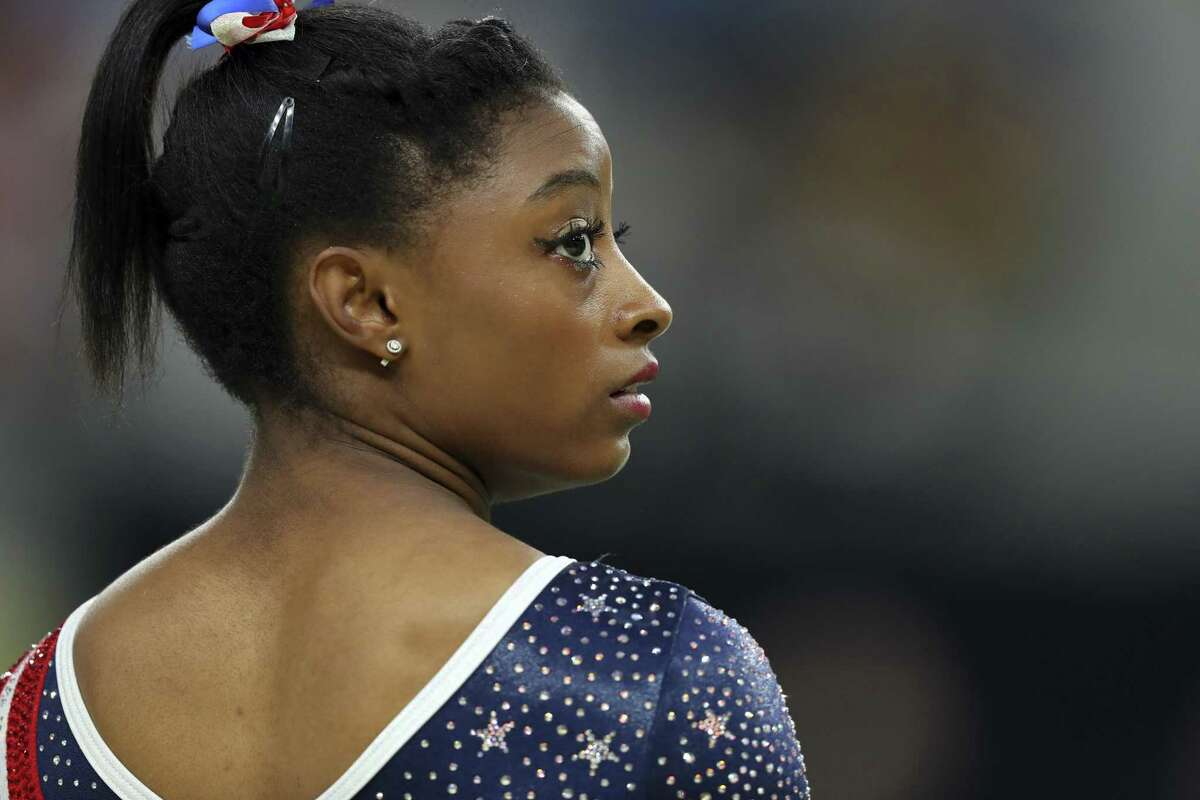 FILE ?- Simone Biles represents the United States in the women?'s gymnastics team finals at the Olympics in Rio de Janeiro, Aug. 9, 2016. Biles, one of the most decorated gymnasts in Olympic history, added her own name to the those who have accused Lawrence Nassar, the former team doctor for USA Gymnastics, of sexual abuse, on Jan. 15, 2018. (Chang W. Lee/The New York Times)